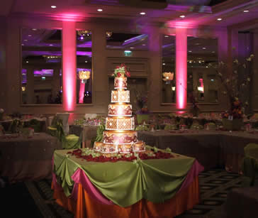 Ambient Up-Lighting and Wedding Event Lighting Design from Edge Sight and Sound Tulsa and Wichita with cake lights